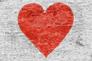 Symbol of love painted on brick wall